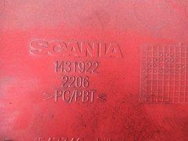 Пластиковое уплотнение фары лев. (высокий) Scania СR